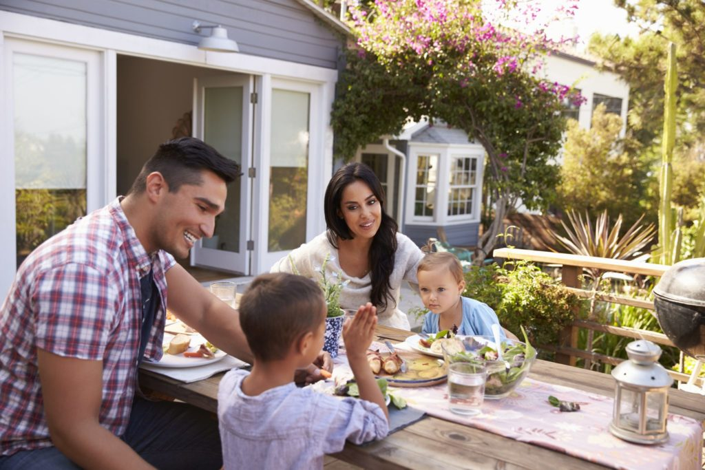 Family meal outdoors